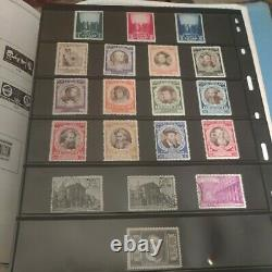 Exciting worldwide stamp collection in mammoth Minkus album. 1800s forward A+