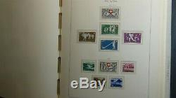 Switzerland stamp collection in Lighthouse hingeless album with 550 stamps'45 -75