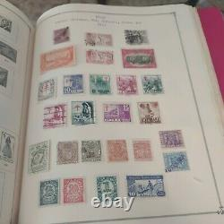 Worldwide stamp collection in grand award Scott album. Collection is 1800s fwd